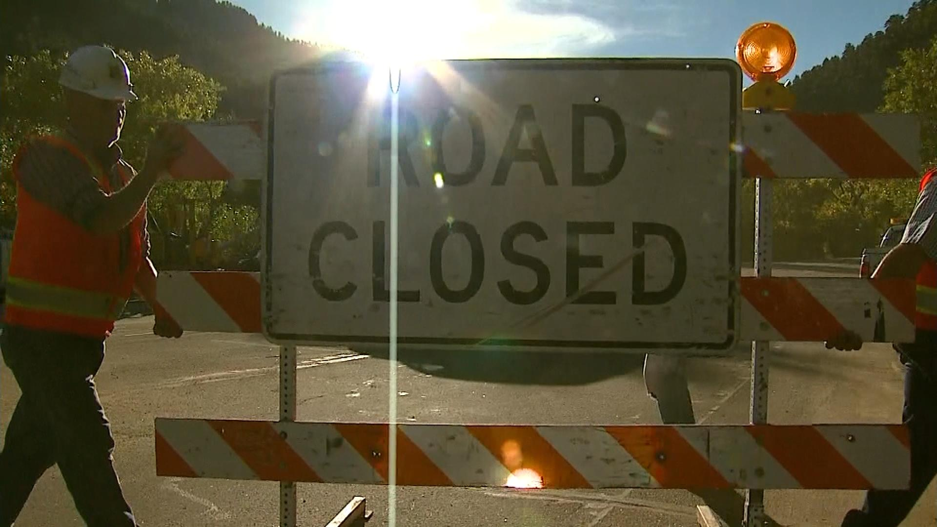 Officials move away the roadblocks on Sunday. (credit: CBS)