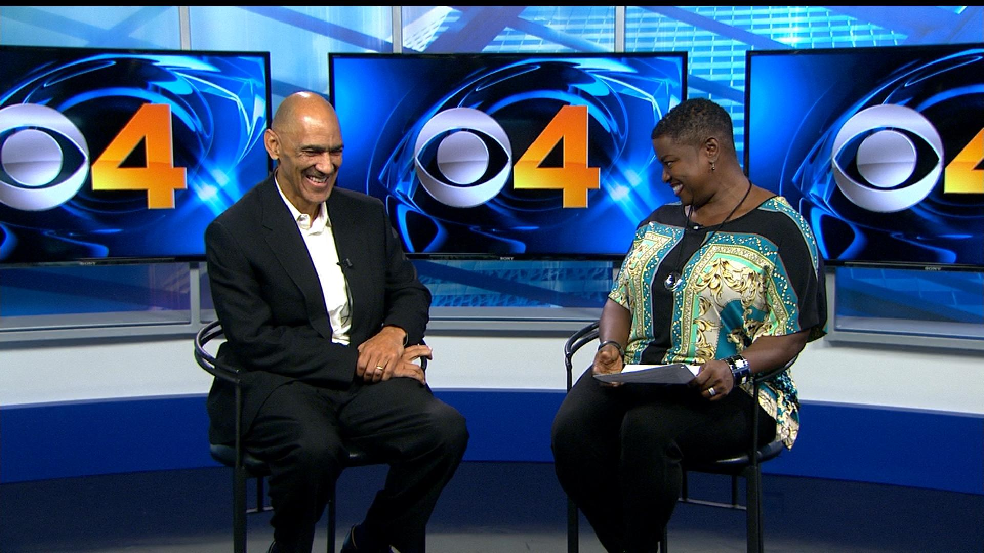 CBS4's Gloria Neal shares a laugh with former football coach Tony Dungy. (Credit: CBS)