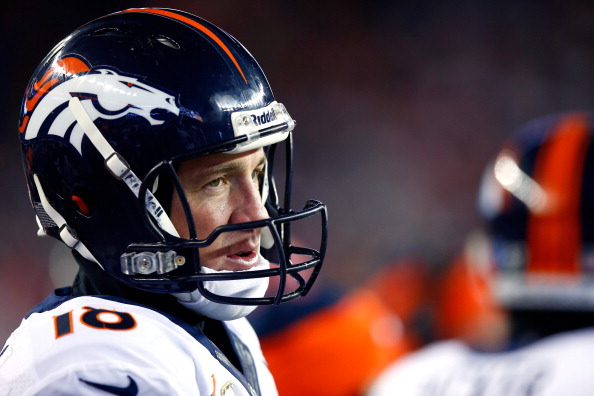 Quarterback Peyton Manning #18 of the Denver Broncos looks on from the sideline during a game against the New England Patriots at Gillette Stadium on November 24, 2013 in Foxboro, Massachusetts.  (Photo by Jared Wickerham/Getty Images)