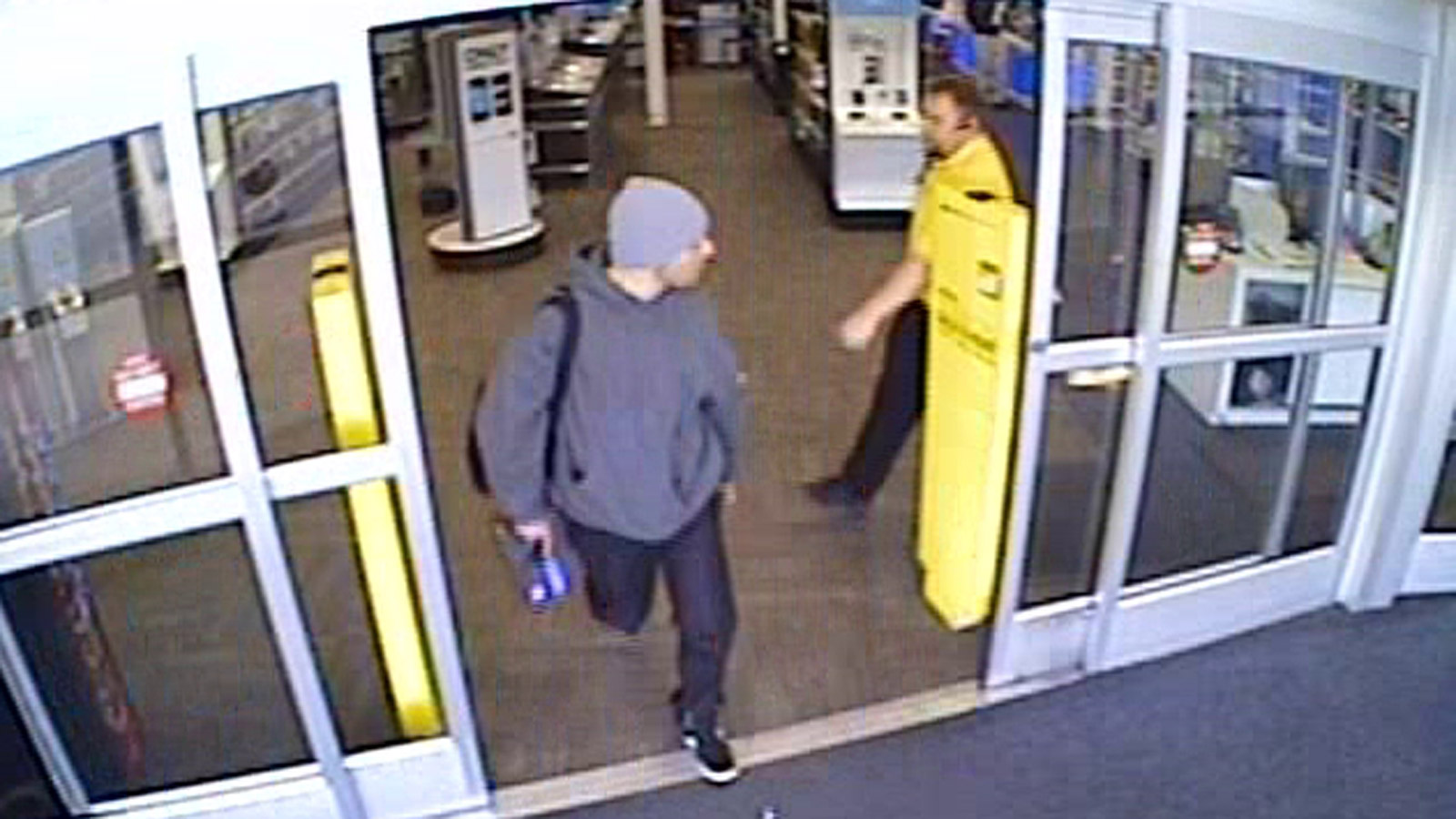 Police in Lakewood are hoping to catch this suspect who robbed a Best Buy and sprayed an employee with pepper spray (credit: Lakewood Police)