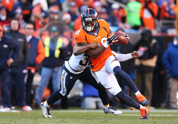 Demaryius Thomas of the Denver Broncos tries to break the tackle of Eric Weddle of the San Diego Chargers during the AFC Divisional Playoff Game at Sports Authority Field at Mile High on Jan. 12, 2014. (Photo by Christian Petersen/Getty Images)