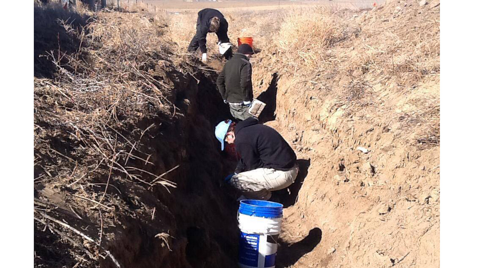 Investigators search for evidence after human remains were found near the Front Range Airport (credit: Adams County Sheriff's Office)