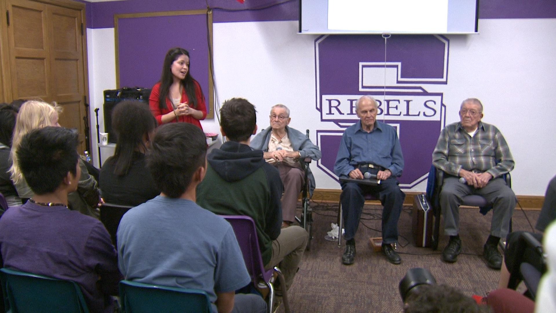 Students talk with Harold Haberman, left, Carl Hammergren, center, and Earl Lammers, right (credit: CBS)