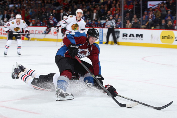 Matt Duchene #9 of the Colorado Avalanche controls the puck against the defense of Johnny Oduya #27 of the Chicago Blackhawks at Pepsi Center on March 12, 2014 in Denver, Colorado.  (Photo by Doug Pensinger/Getty Images)