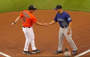 Head coach Mike Redmond #11 of the Miami Marlins and head coach Walt Weiss #22 of the Colorado Rockies shake hands during Opening Day  at Marlins Park on March 31, 2014 in Miami, Florida.  (Photo by Mike Ehrmann/Getty Images)