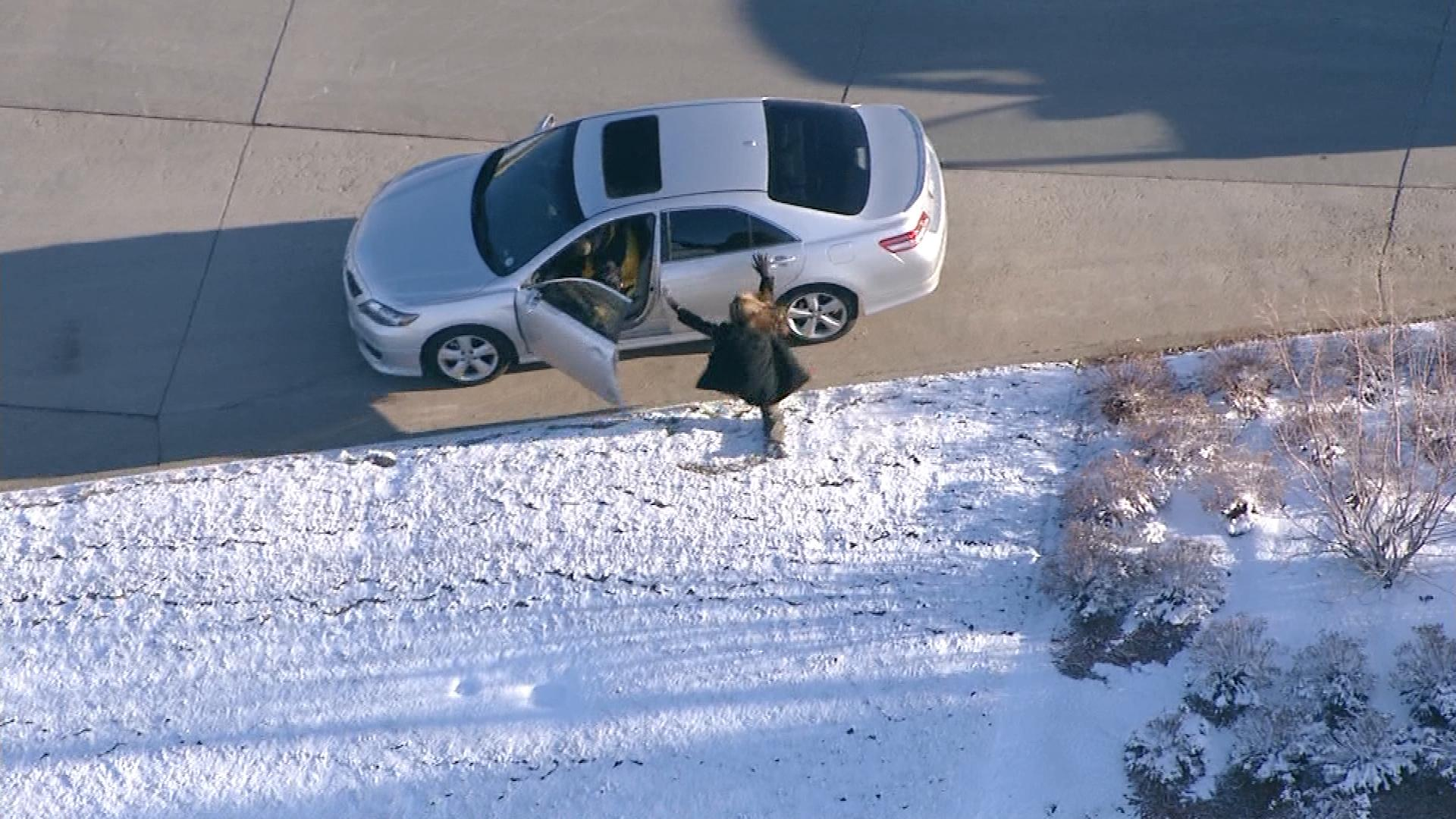 A woman gets carjacked on March 12, 2014, during the wild chase in the Denver metro area. (credit: CBS)