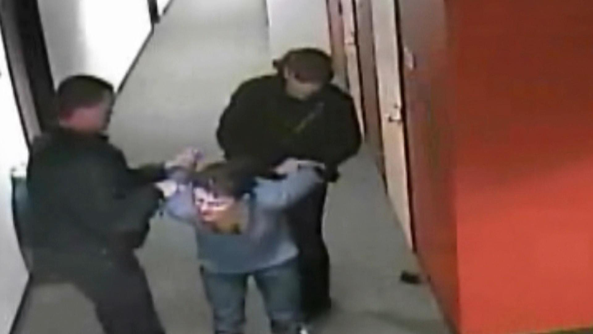 An image of Patricia Lucero  being escorted out of the apartment building (credit; CBS)