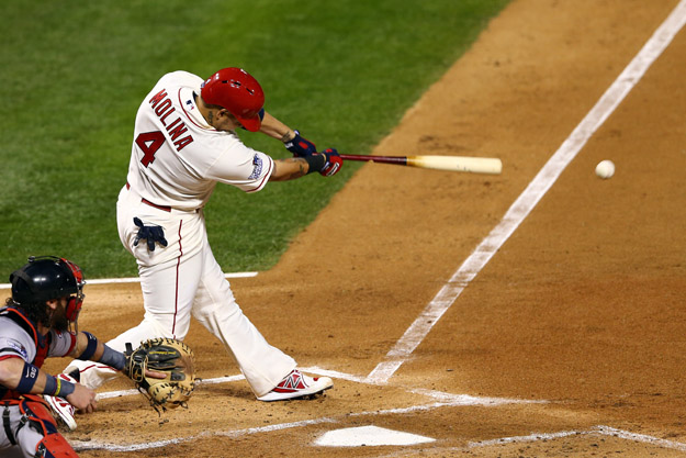 ST LOUIS, MO - OCTOBER 26:  Yadier Molina #4 of the St. Louis Cardinals hits a RBI single in the first inning against the Boston Red Sox during Game Three of the 2013 World Series at Busch Stadium on October 26, 2013 in St Louis, Missouri.