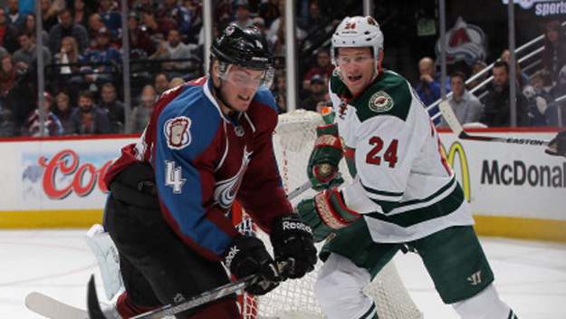 Tyson Barrie #4 of the Colorado Avalanche clears the puck away from Matt Cooke #24 and Kyle Brodziak #21 of the Minnesota Wild in Game Two of the First Round of the 2014 NHL Stanley Cup Playoffs at Pepsi Center on April 19, 2014 in Denver, Colorado.  (Photo by Doug Pensinger/Getty Images)