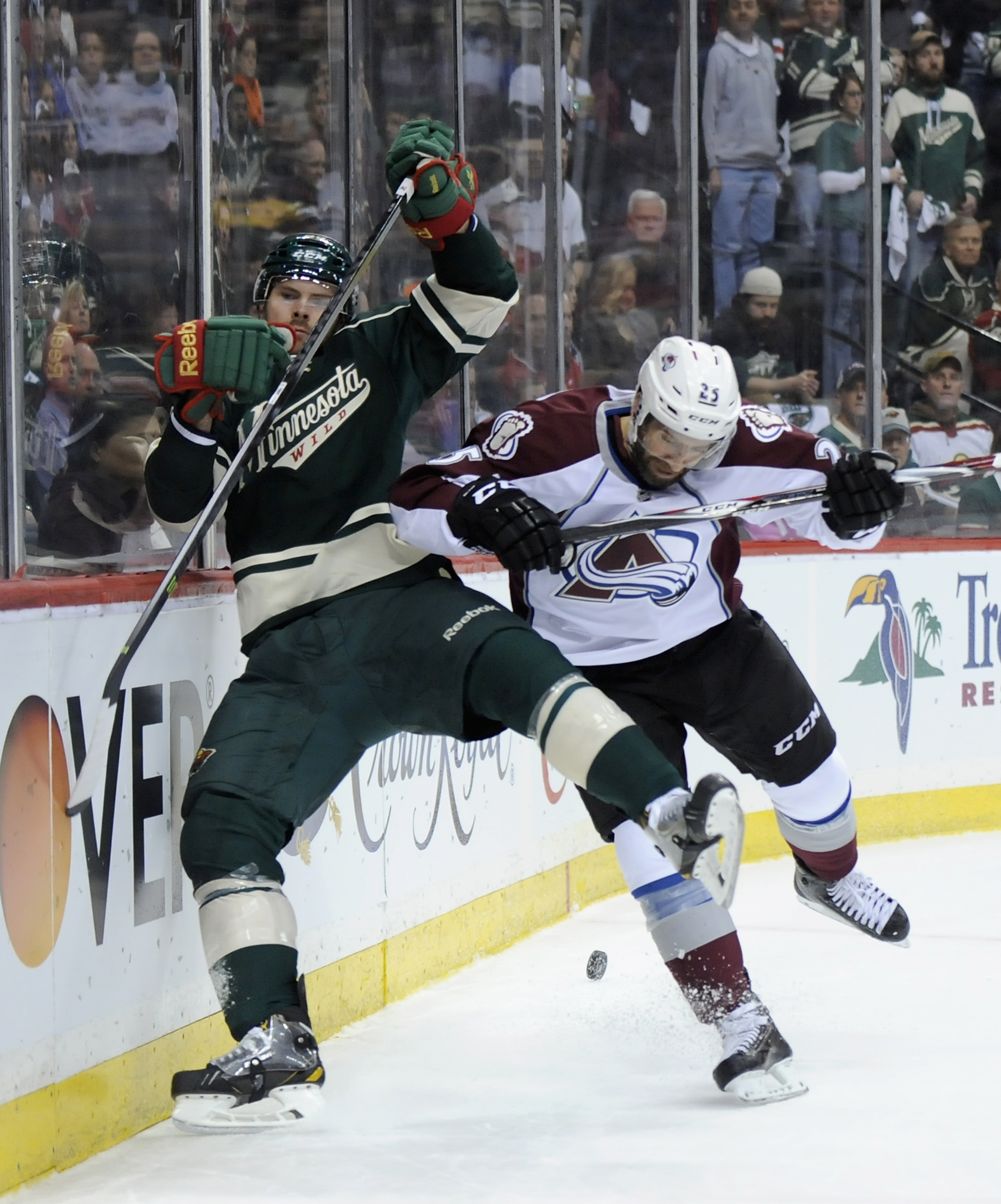 Maxime Talbot #25 of the Colorado Avalanche checks Nate Prosser #39 of the Minnesota Wild into the boards during the first period in Game Four of the First Round of the 2014 NHL Stanley Cup Playoffs on April 24, 2014 at Xcel Energy Center in St Paul, Minnesota. (Photo by Hannah Foslien/Getty Images)