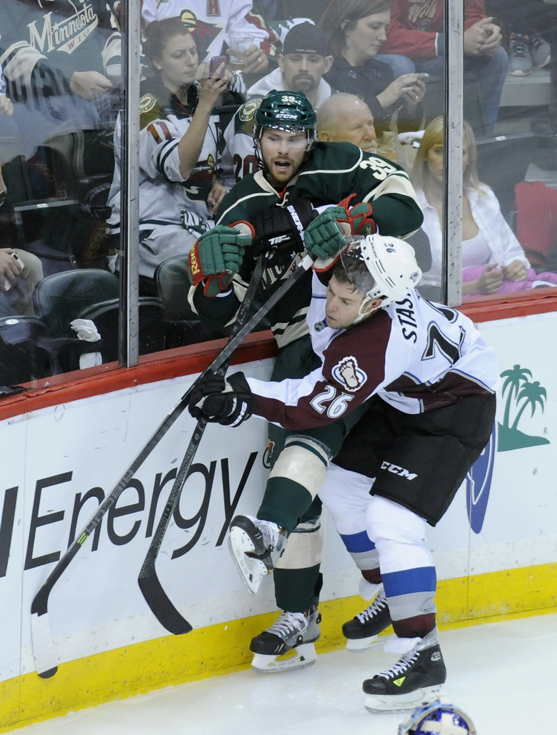 Paul Stastny #26 of the Colorado Avalanche checks Nate Prosser #39 of the Minnesota Wild into the boards during the second period in Game Four of the First Round of the 2014 NHL Stanley Cup Playoffs on April 24, 2014 at Xcel Energy Center in St Paul, Minnesota. The Wild defeated the Avalanche 2-1.  (Photo by Hannah Foslien/Getty Images)