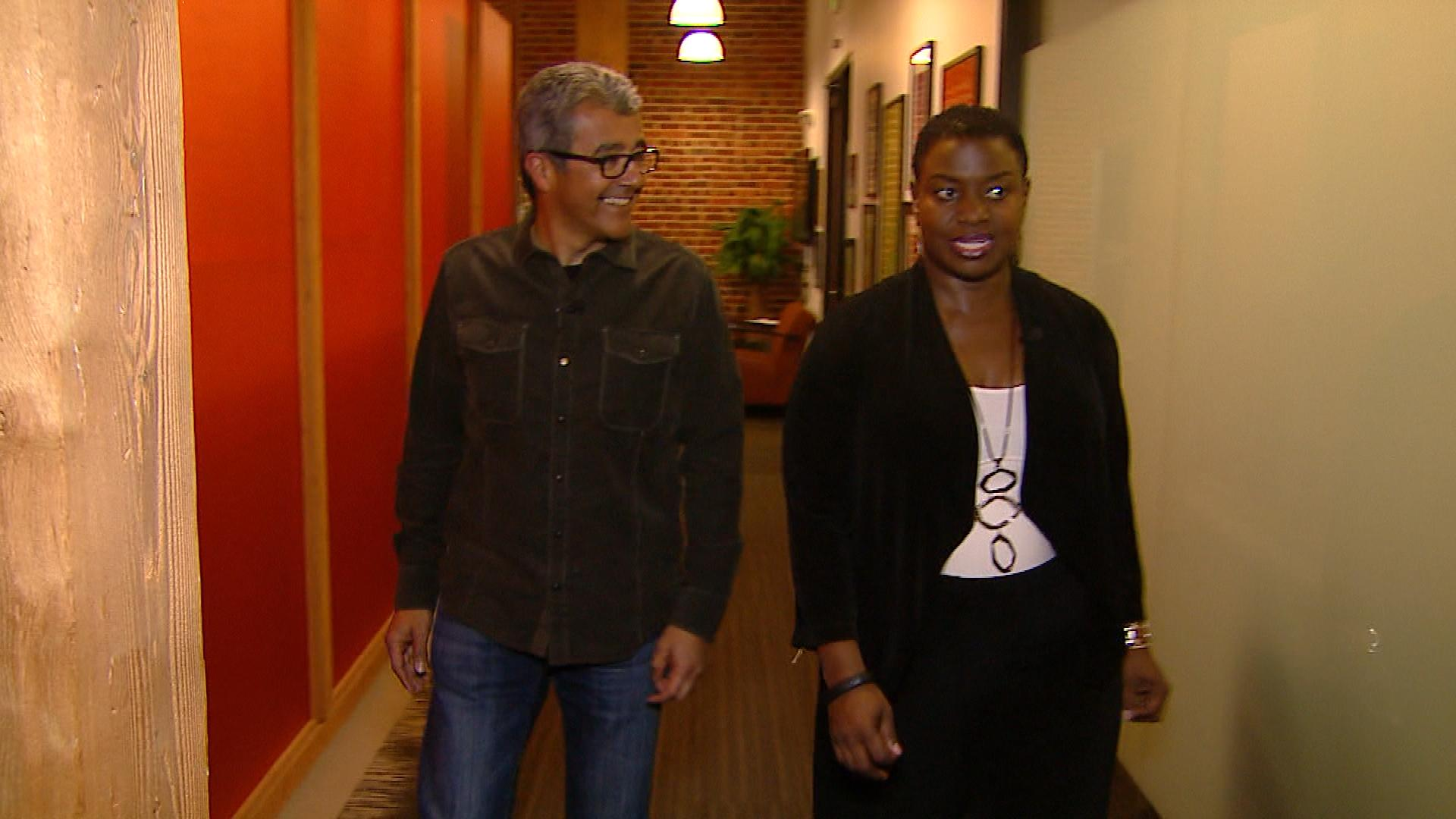 CBS4's Gloria Neal walks with Wayne Guerra, co-founder of iTriage. (Credit: CBS)