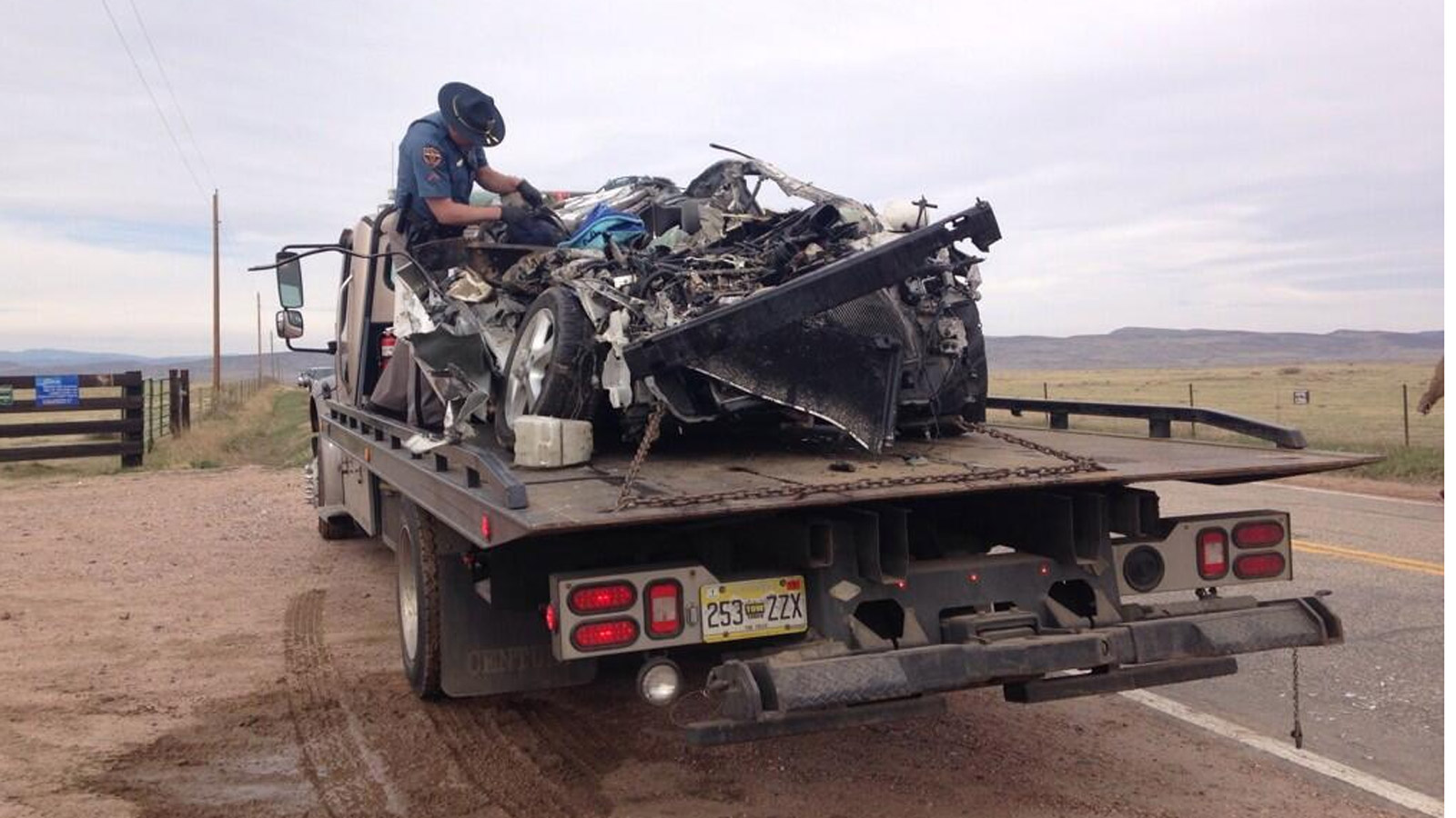 The car involved in the school bus crash in Larimer County after it was removed from under the bus. (credit: CBS)