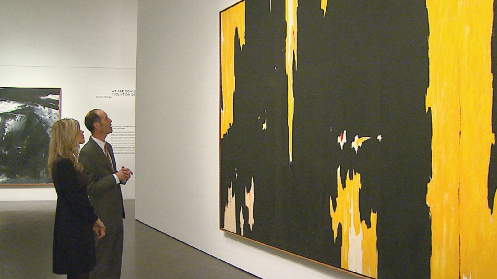 CBS4's Lauren Whitney and curator Dean Sobel look at a piece in the Modern Masters exhibit at the Denver Art Museum (credit: CBS)