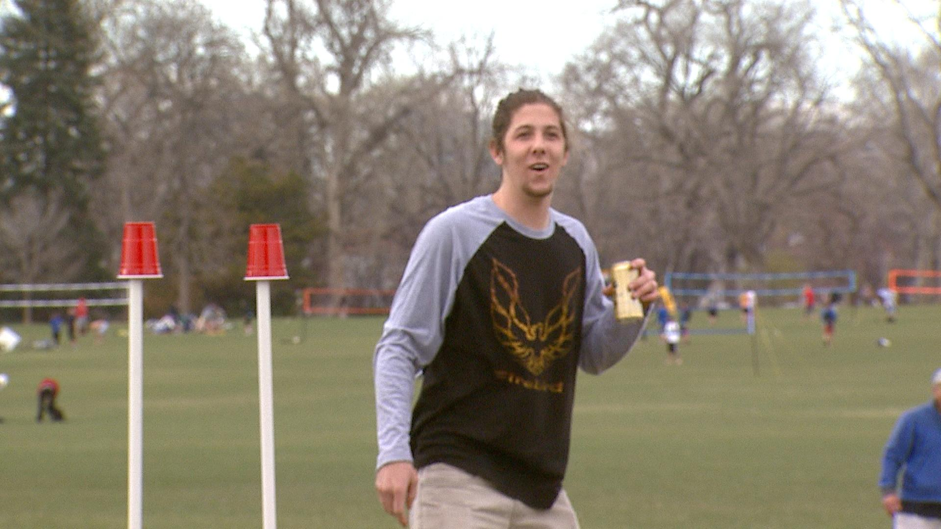 D.J. Stone playing Frisbee while enjoying a beer in Washington Park (credit: CBS)