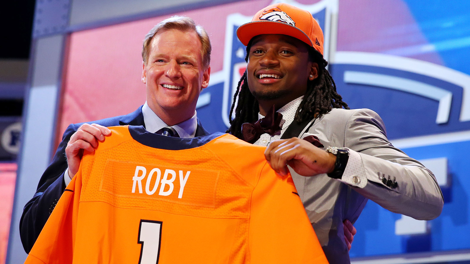 Bradley Roby of the Ohio State Buckeyes poses with NFL Commissioner Roger Goodell after he was picked #31 overall by the Denver Broncos during the first round of the 2014 NFL Draft at Radio City Music Hall on May 8, 2014 in New York City.  (Photo by Elsa/Getty Images)