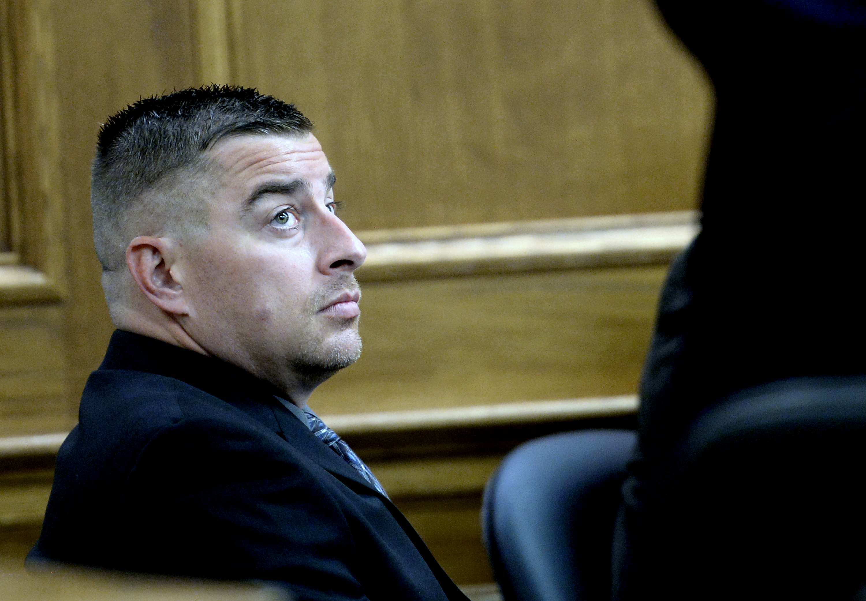 Former Boulder police Officer Sam Carter listens during the start of jury selection for his case in the shooting of a trophy elk on Mapleton Hill (credit: BOULDER DAILY CAMERA/Mark Leffingwell)
