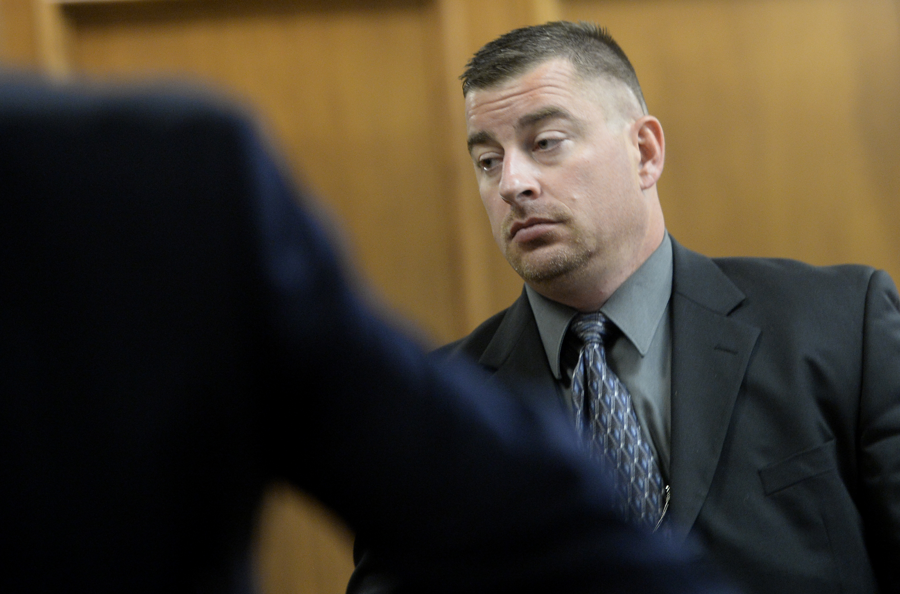 Former Boulder police Officer Sam Carter leaves for a break in jury selection for his trial in the shooting of a trophy elk on Mapleton Hill during jury selection (credit: BOULDER DAILY CAMERA/ Mark Leffingwell)
