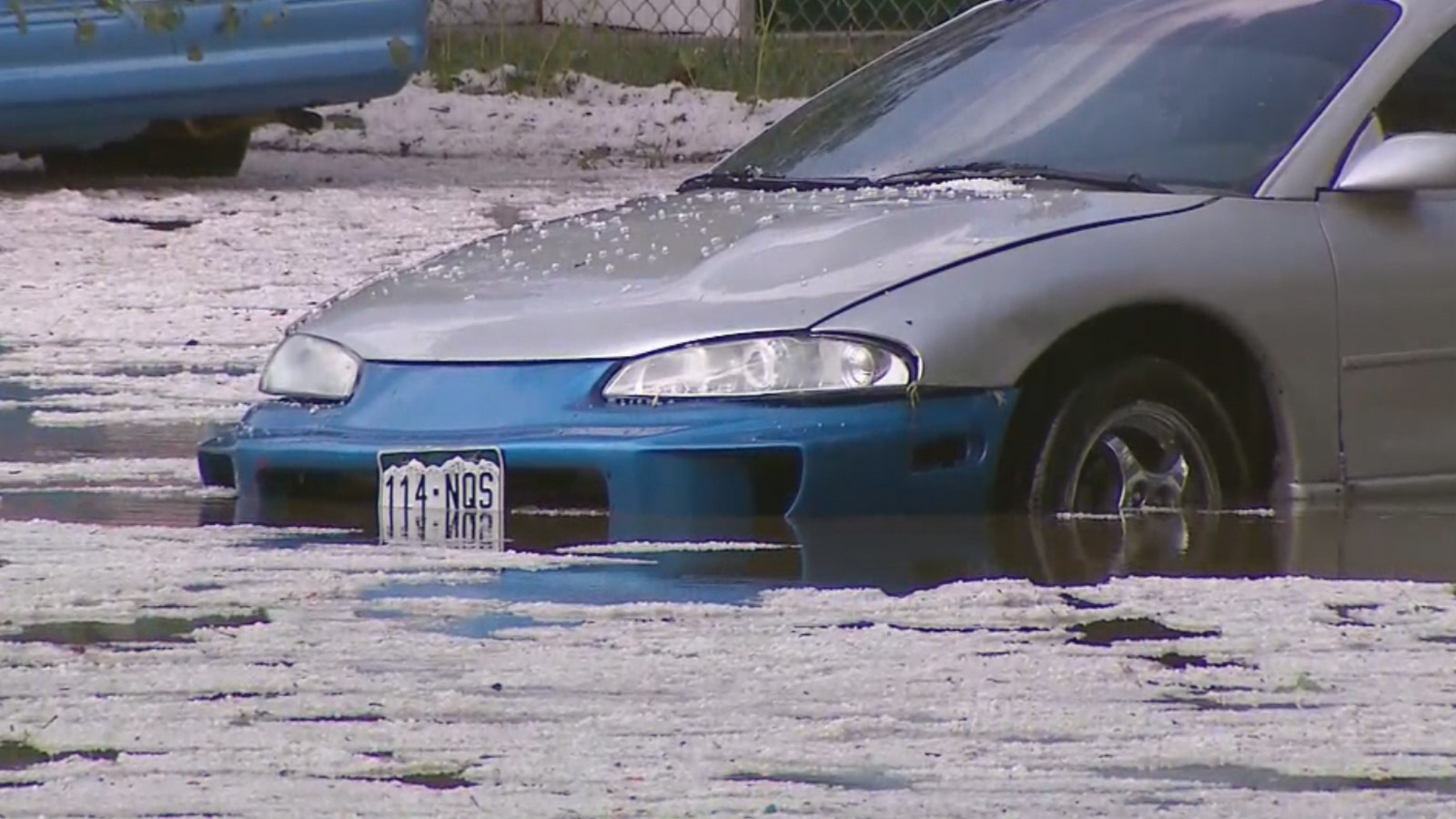 Hail floats atop flood waters in Aurora after severe storms hit Wednesday afternoon (credit: CBS)