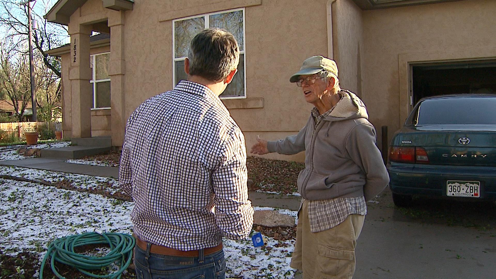 Robert Peters shows unmelted hail on his lawn. (credit: CBS)