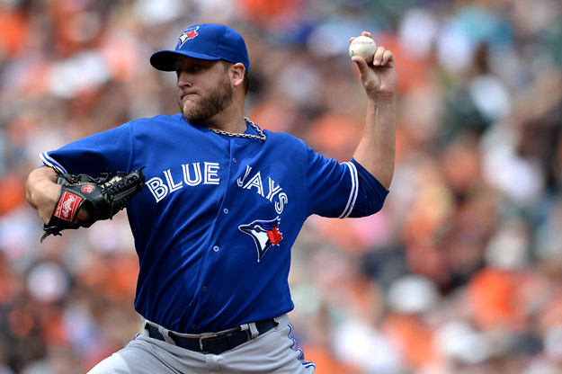 BALTIMORE, MD - APRIL 13: Starting pitcher Mark Buehrle #56 of the Toronto Blue Jays works the first inning against the Baltimore Orioles at Oriole Park at Camden Yards on April 13, 2014 in Baltimore, Maryland.