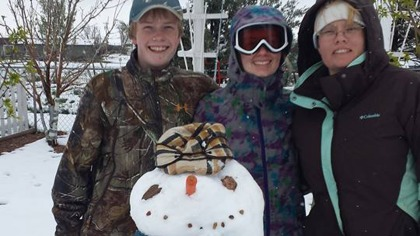 A Wellington family build's a snowman with mom during the Mother's Day snowstorm of 2014. (credit: Trish Perske-Hagerman)