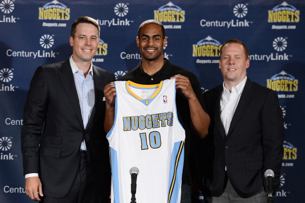 (L/R) President Josh Kroenke, Arron Afflalo #10 and General Manager Tim Connelly of the Denver Nuggets pose for a photo during a press conference on June 30, 2014 at the Pepsi Center in Denver, Colorado. (Photo by Garrett W. Ellwood/NBAE via Getty Images)
