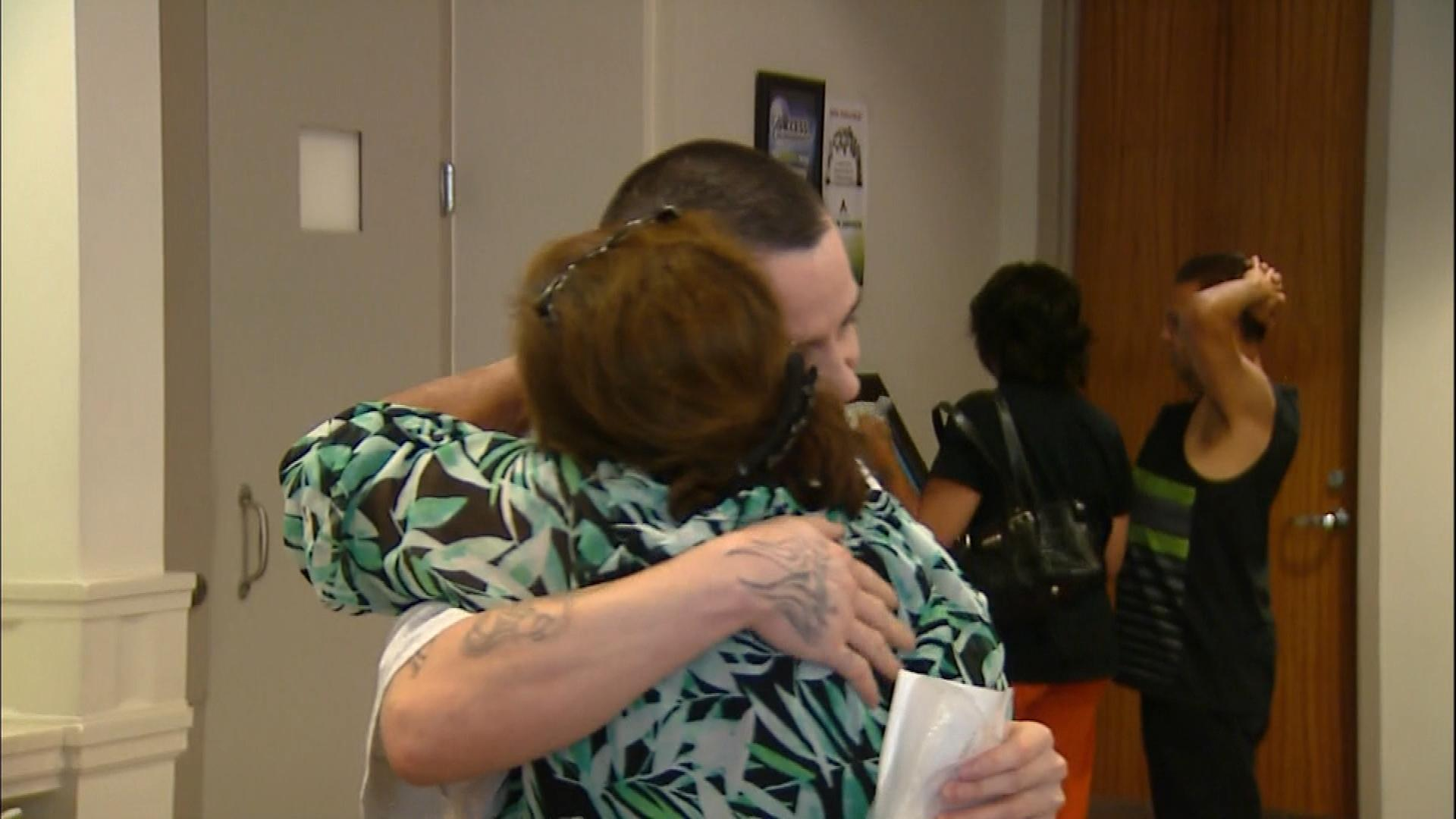 Lorenzo Montoya gets a hug after his release (credit: CBS)