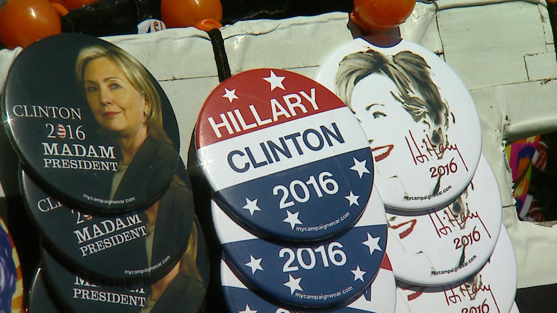 Buttons supporting Clinton (credit: CBS)