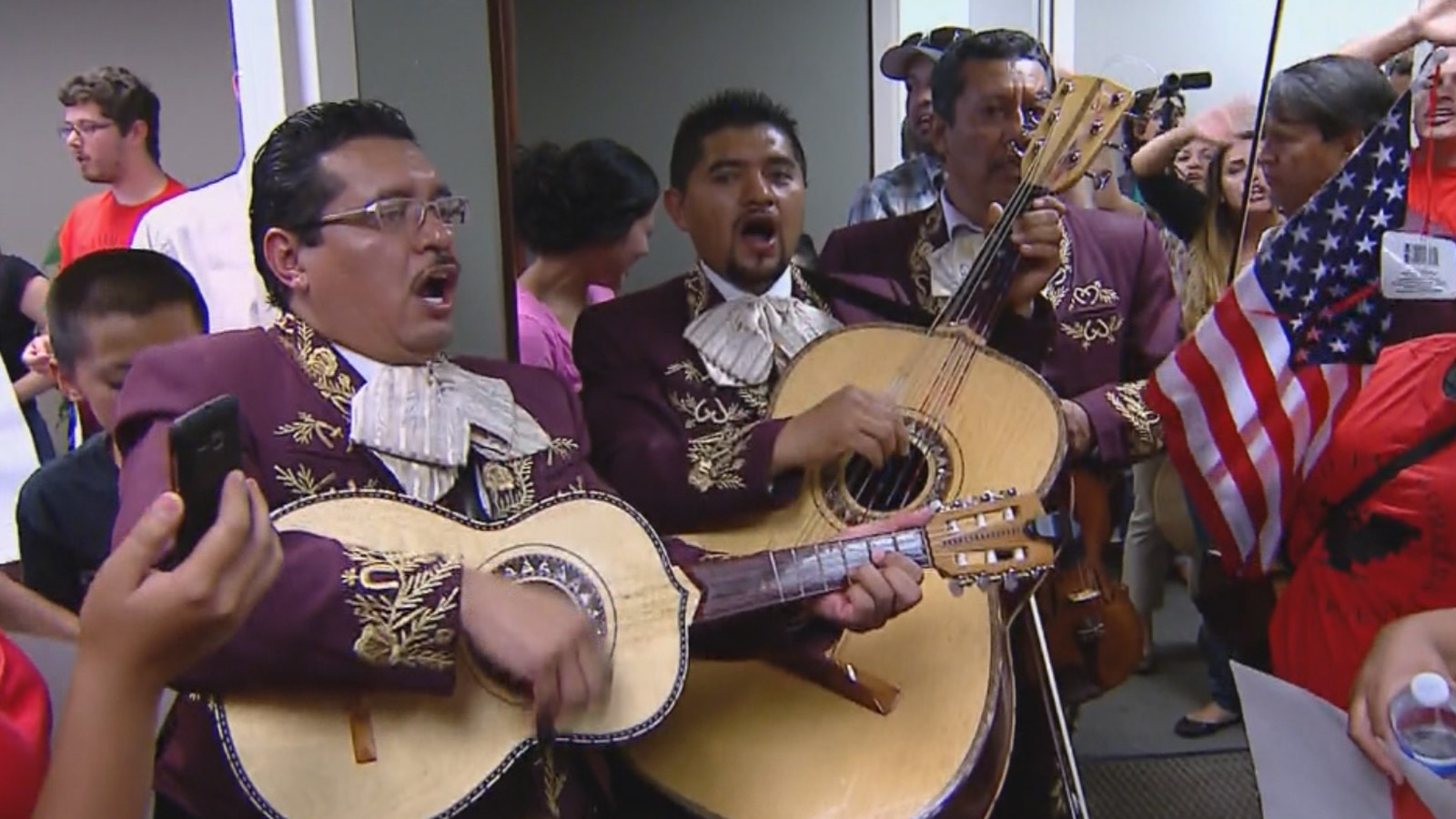 Protesters calling for immigration reform and a mariachi band crowded Rep. Cory Gardner's office on Thursday (credit: CBS)