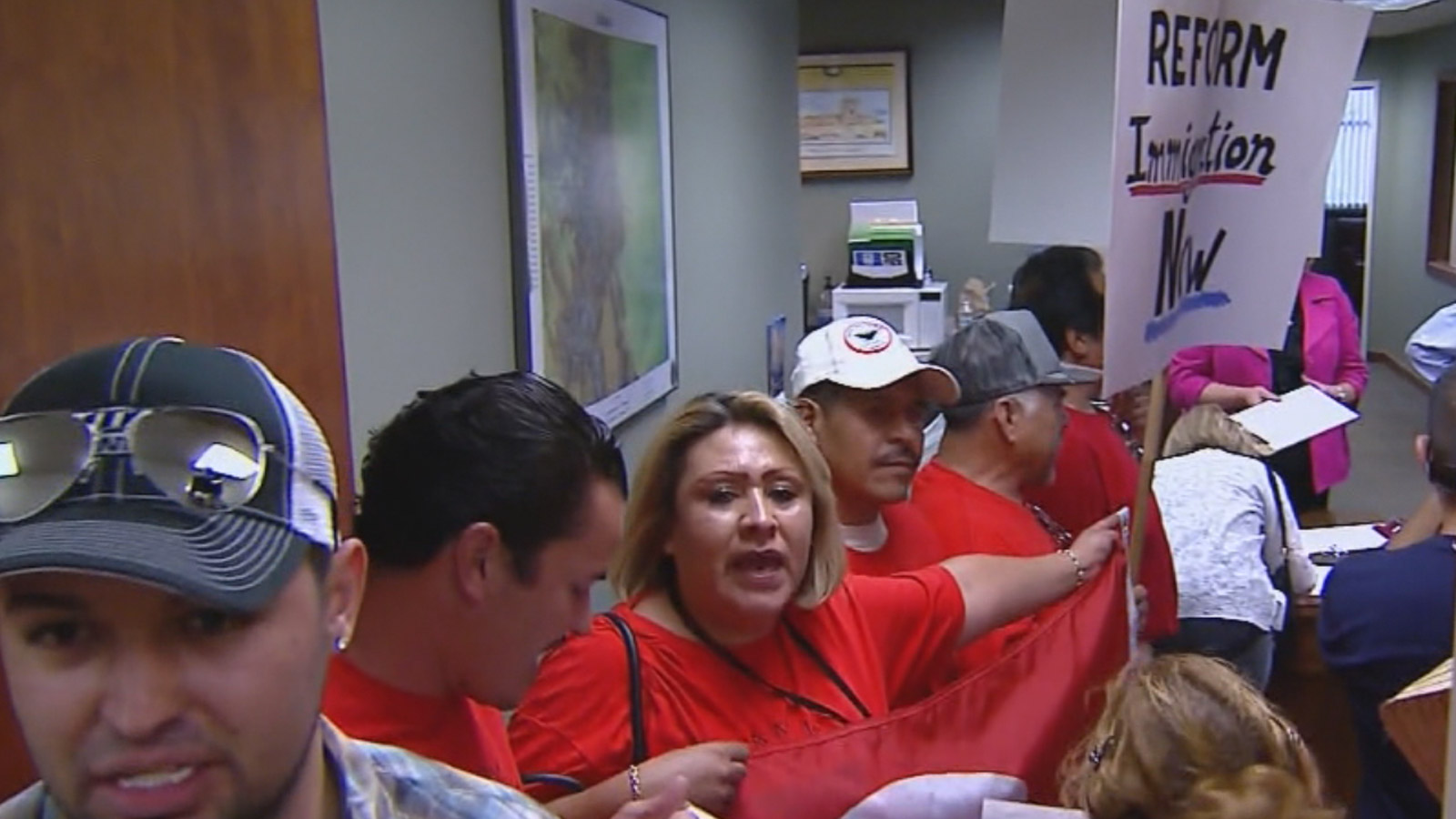 Protesters calling for immigration reform crowded Rep. Cory Gardner's office on Thursday (credit: CBS)