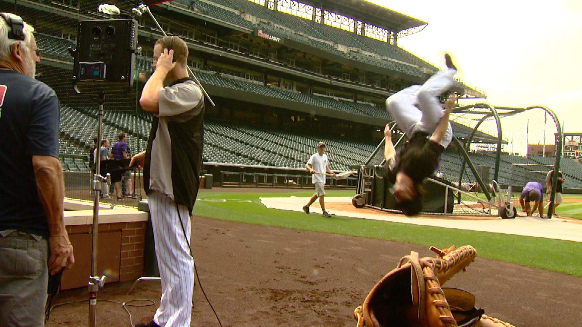 Charlie Culberson doing a backflip behind Justin Morneau while he was doing a TV interview (credit: CBS)