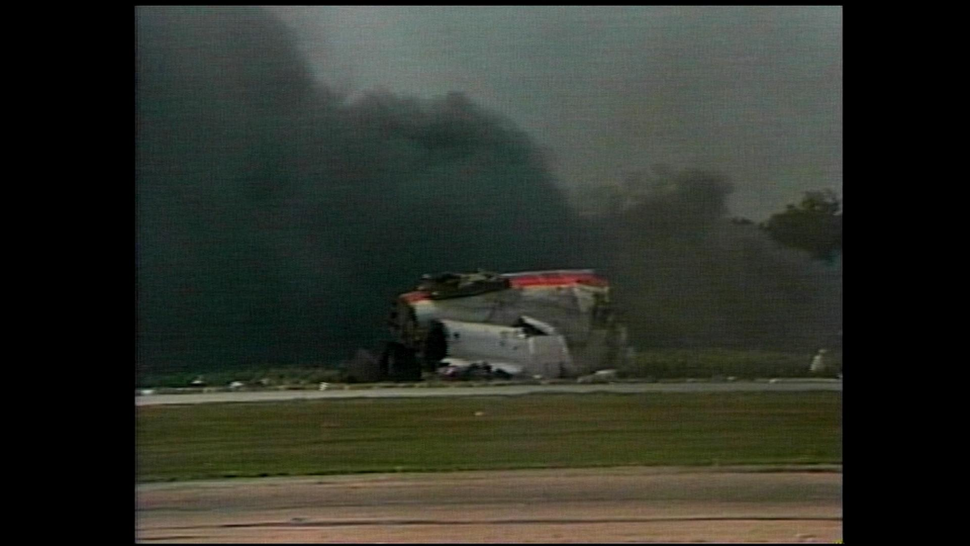 Smoke billows from the fuselage. (credit: CBS)