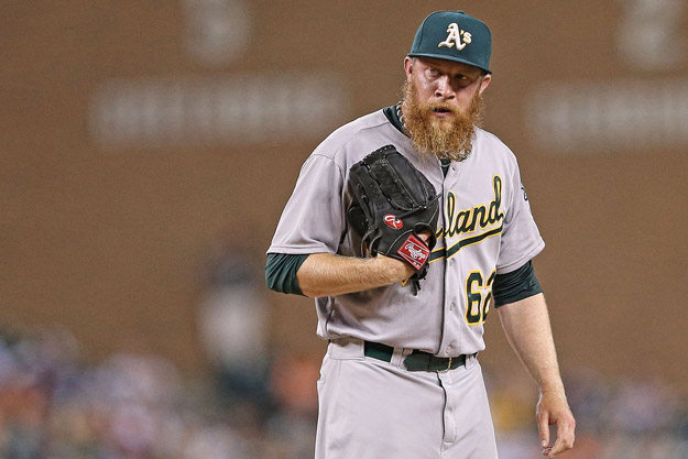 DETROIT, MI - JUNE 30: Sean Doolittle #61 of the Oakland Athletics looks in at home plate during the ninth inning of the game against the Detroit Tigers at Comerica Park on June 30, 2014 in Detroit, Michigan. The Tigers won the game on a walk off grand slam home run by Rajai Davis #20. The Tigers defeated the Athletics 5-4.