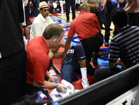 Paul George #29 of the 2014 USA Basketball Men's National Team is tended to as he lies on the court after badly injuring his leg defending a play during a USA Basketball showcase at the Thomas & Mack Center on August 1, 2014 in Las Vegas, Nevada. The rest of the exhibition was cancelled after the injury.  (Photo by Ethan Miller/Getty Images)