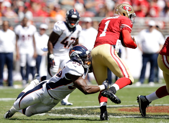 Quarterback Josh Johnson #1 of the San Francisco 49ers runs with the ball against Steven Johnson #53 of the Denver Broncos during a preseason game at Levi's Stadium on August 17, 2014 in Santa Clara, California.  (credit: Ezra Shaw/Getty Images)