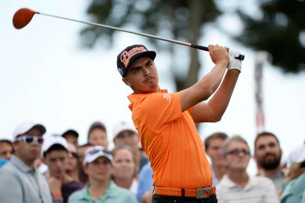 Rickie Fowler plays his shot from the 13th tee during the final round of The Barclays.  (Photo by Ross Kinnaird/Getty Images)