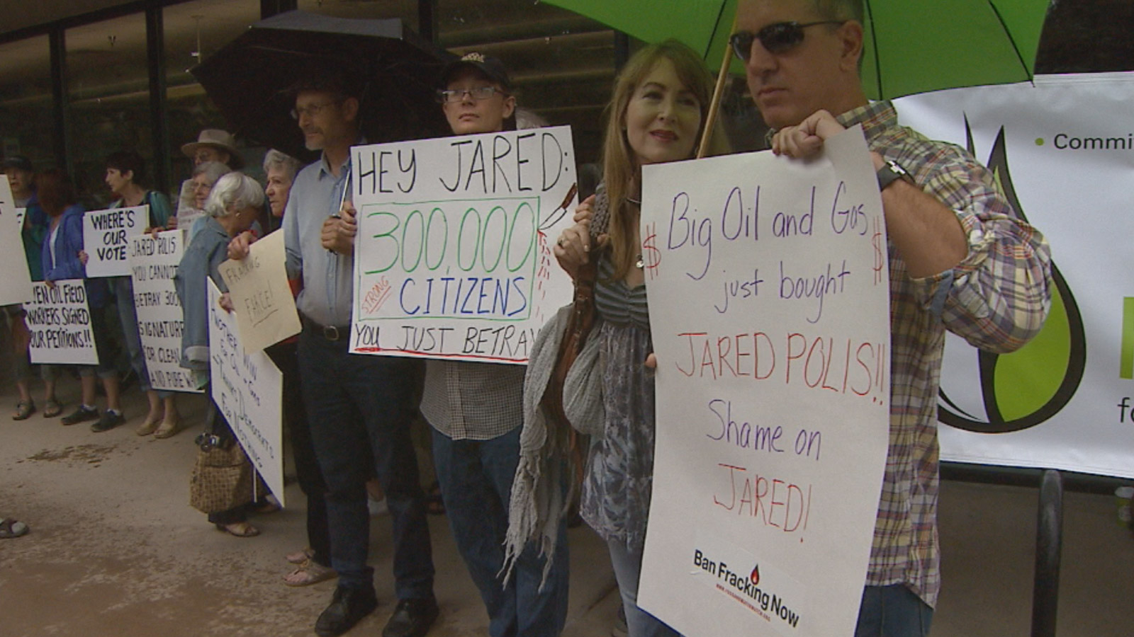 Activists protest a fracking compromise between Gov. Hickenlooper and Rep. Jared Polis (credit: CBS)
