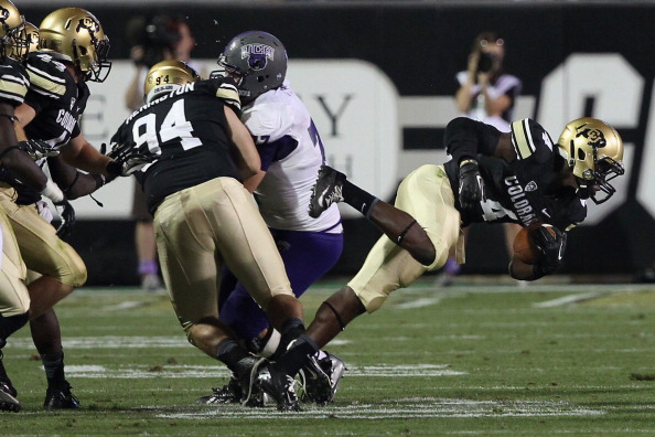 Defensive back Chidobe Awuzie runs with the ball after stripping it from Central Arkansas wide receiver Jatavious Wilson during a game in Boulder in 2013. (Photo by Doug Pensinger/Getty Images)