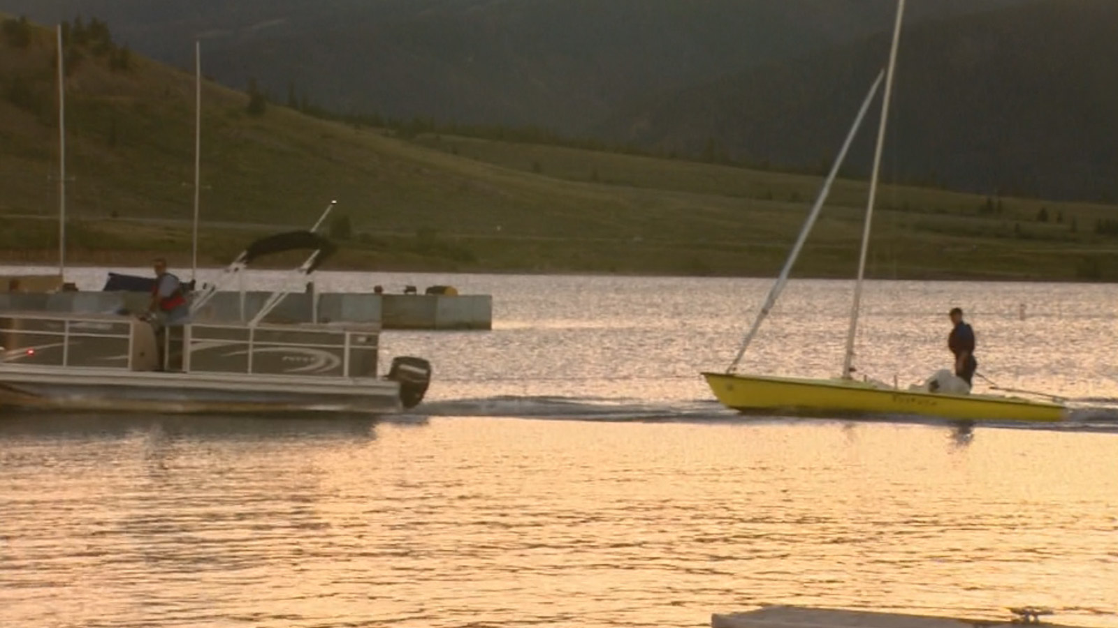 A boat tows another boat after it capsized on Lake Dillon Thursday evening (credit: CBS)