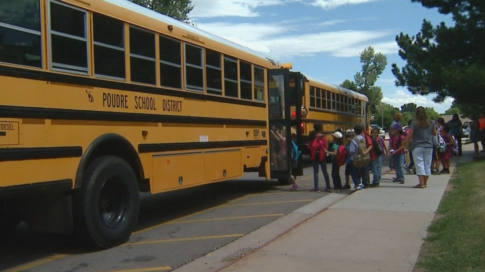 Students get on buses after being released early for hot weather (credit: CBS)