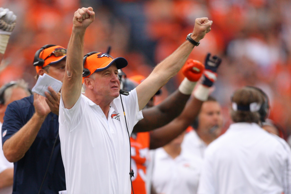 Head coach John Fox of the Denver Broncos celebrates as the defense finishes a fourth-quarter stand to preserve the win over the Kansas City Chiefs at Sports Authority Field at Mile High on Sept. 14, 2014. (credit: Dustin Bradford/Getty Images)