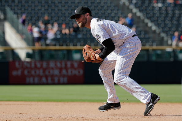 First baseman Ben Paulsen #4 of the Colorado Rockies plays defense against the Los Angeles Dodgers at Coors Field on September 17, 2014 in Denver, Colorado. The Rockies defeated the Dodgers 16-2.  (Photo by Doug Pensinger/Getty Images)