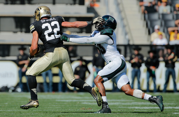 Wide receiver Nelson Spruce #22 of the Colorado Buffaloes makes a reception and fends off defensive back Taz Stevenson #33 of the Hawaii Rainbow Warriors at Folsom Field on September 20, 2014 in Boulder, Colorado. The Buffaloes defeated the Warriors 21-12.  (Photo by Doug Pensinger/Getty Images)