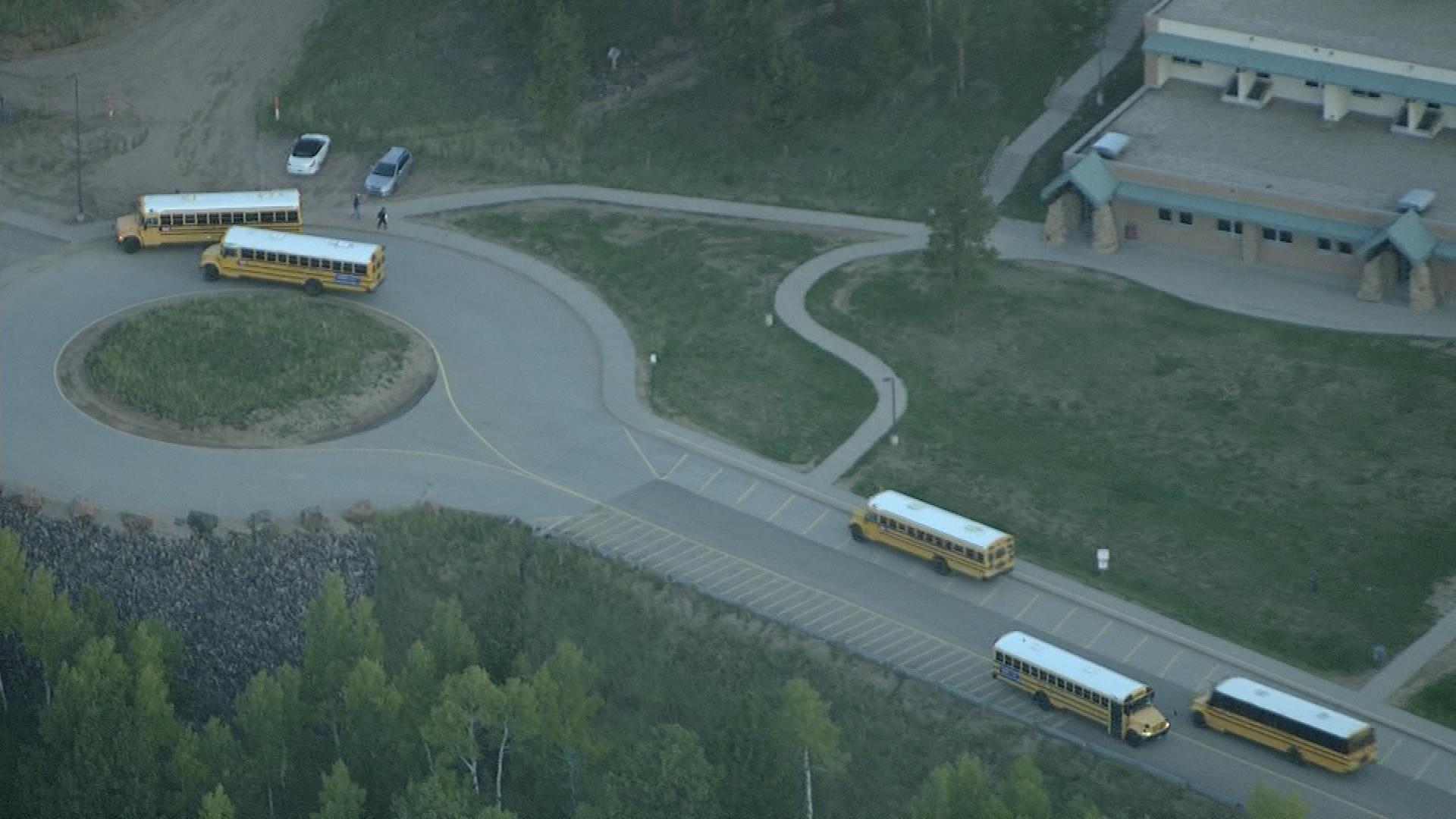 Empty buses at Conifer High School on Friday morning (credit: CBS)