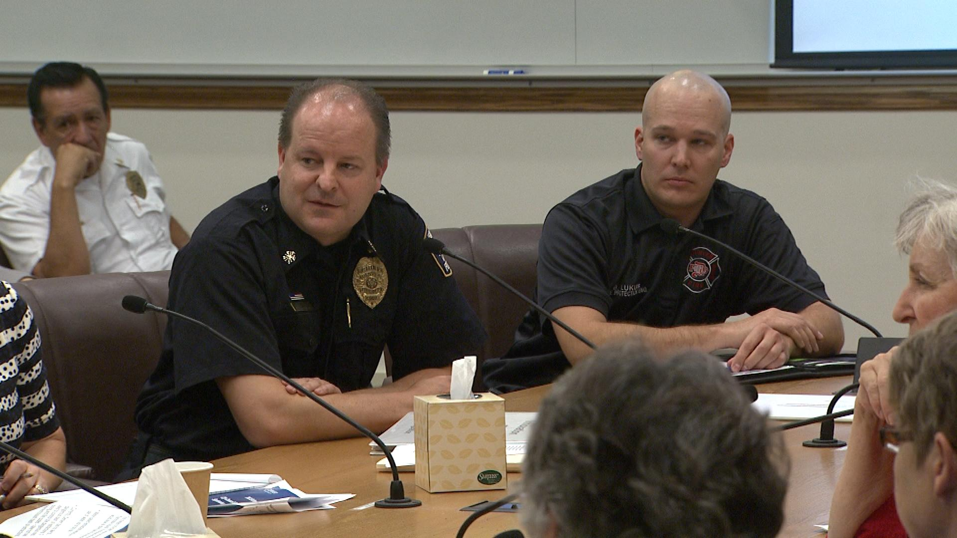 Denver Fire Department Chief Eric Tade, left, during Tuesday's City Council hearing (credit: CBS)