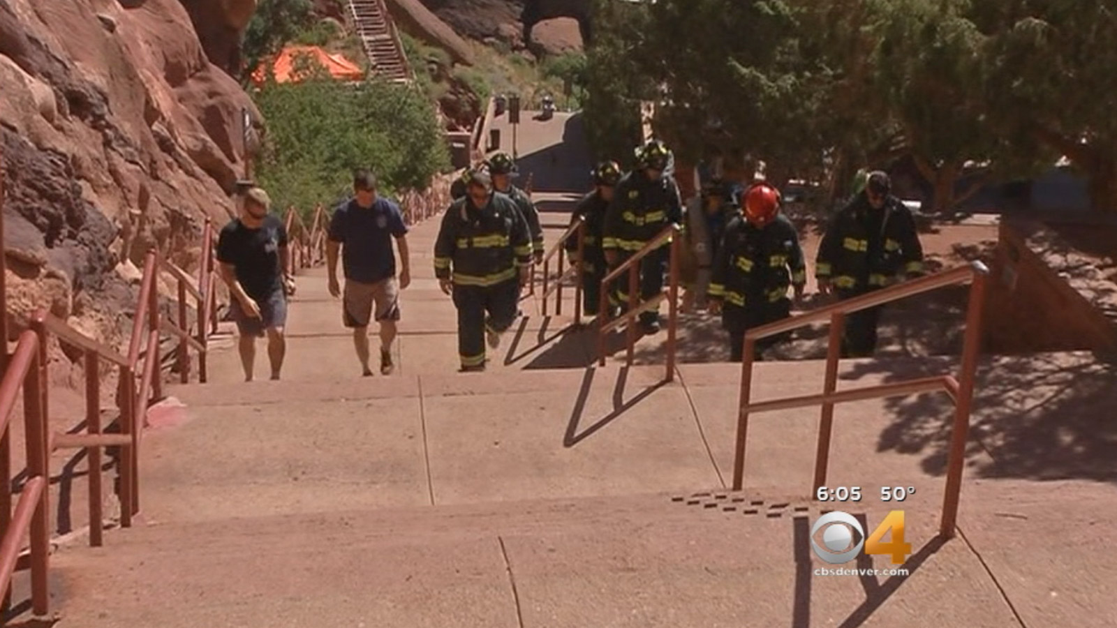 Firefighters climb the stairs at Red Rocks as a tribute to 9/11. (credit: CBS)