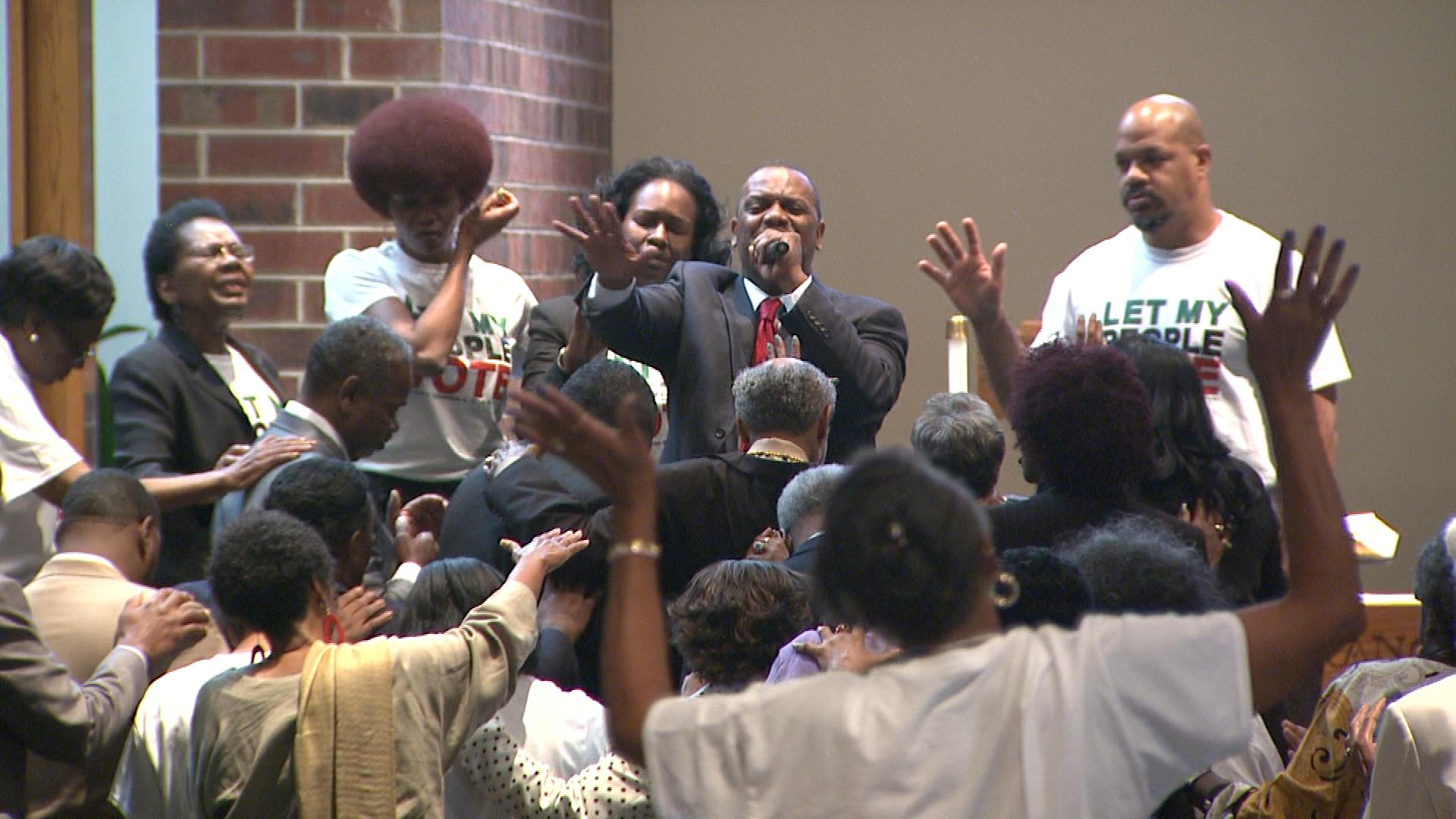 Shorter Community AME Church Pastor Timothy E. Tyler talks to the gathering on Sunday (credit: CBS)