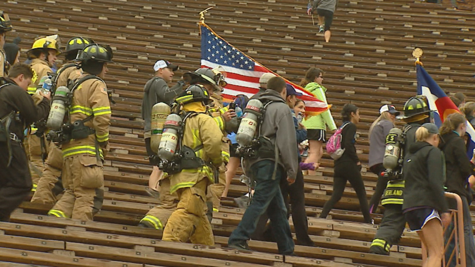 Firefighters join others at Red Rocks Amphitheatre to honor those killed on 9/11. (credit: CBS)