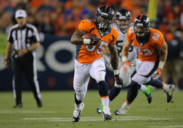Running back Kapri Bibbs #35 of the Denver Broncos runs with the ball against the Seattle Seahawks during preseason action at Sports Authority Field at Mile High on Aug. 7, 2014.  (Photo by Doug Pensinger/Getty Images)